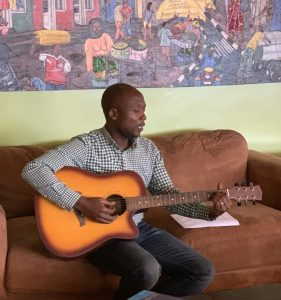 Narcisse enjoying a rare moment of downtime in Kigali.